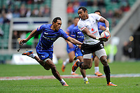 Donasio Ratubuli of Fiji passes ahead of Tulolo Tulolo of Samoa during Day Two of the iRB Marriott London Sevens at Twickenham on Sunday 11th May 2014 (Photo by Rob Munro)