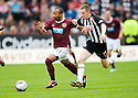 HEARTS' MEHDI TAOUIL IS BROUGHT DOWN BY PARS PAUL BURNS