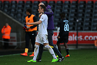 SWANSEA, WALES - MARCH 25: Swansea City coach Cameron Toshack wraps his arm around the shoulders of Connor Roberts of Swansea City after the final whistle of the Premier League International Cup Semi Final match between Swansea City and Porto at The Liberty Stadium on March 25, 2017 in Swansea, Wales. (Photo by Athena Pictures)Athena Pictures)
