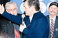 NH State Representatives Gary S. Hopper (R-Weare-Deering) (left) and Rick Christie (R-Goffstown) look on as Texas senator and Republican presidential candidate Ted Cruz speaks at The Village Trestle restaurant in Goffstown, New Hampshire, on Wed., Feb. 3, 2016.