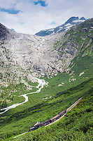Railway to the mountains. Hiking by train through the Swiss Alps.