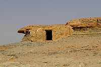 """The tomb is one the 300 located on the Roman necropolis of Al-Muzawaka in the western desert of Egypt. A family grave was the solution for the """"higher middle class"""" of ancient times in Egypt. The tomb is located on a table-top mountain and it must be interpreted to be an effective connection to the afterlife. Tombs are dug out all the way around it."""