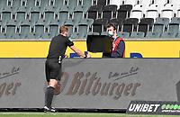 23rd May 2020, BORUSSIA-PARK, North Rhine-Westphalia, Germany; Bundesliga football, Borussia Moenchengladbach versus Bayer Leverkusen. Referee Sören Storkschecks the replay of the tackle that led to the penalty kick award