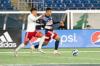 FOXBOROUGH, MA - OCTOBER 16: Edwin Cerrillo #33 of North Texas SC advances on Damian Rivera #72 of New England Revolution II during a game between North Texas SC and New England Revolution II at Gillette Stadium on October 16, 2020 in Foxborough, Massachusetts.