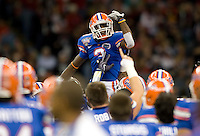 01 January 2010:  Chris Rainey of Florida leads the team into huddle after warm-ups before the game against Cincinnati during Sugar Bowl at the SuperDome in New Orleans, Louisiana.