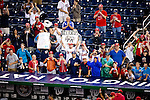 Fans of Washington Nationals outfielder Bryce Harper (34) cheer during a game against the Miami Marlins at Nationals Park in Washington, DC on September 8, 2012.
