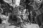 Cart pullers with a overloaded cart at Burrabazzar in Kolkata, India.