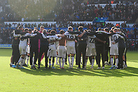 Players of Swansea City huddle at full time during the Sky Bet Championship match between Swansea City and Cardiff City at the Liberty Stadium in Swansea, Wales, UK. Sunday 27 October 2019
