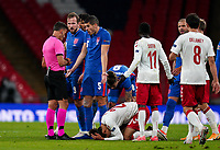 Conor Coady (Wolverhampton Wanderers) of England remonstrates with the Referee Jesús Gil Manzano of Spain after Yussuf Poulsen (RB Leipzig) of Denmark fouls Harry Kane (Tottenham Hotspur) of England during the UEFA Nations League match played behind closed doors due to the current government Covid-19 rules within sports venues between England and Denmark at Wembley Stadium, London, England on 14 October 2020. Photo by Andy Rowland.