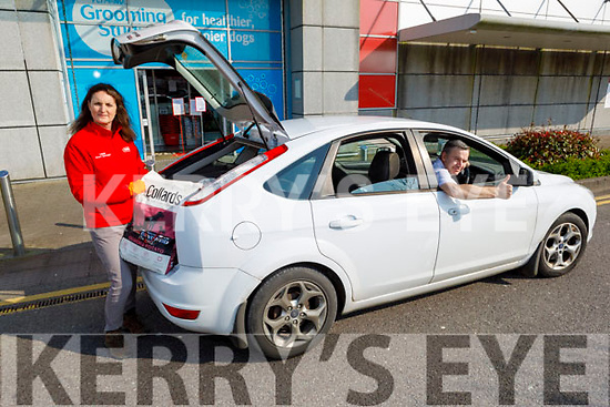 Liam O'Brien getting shop to car delivery from Linda Kavanagh (Manager of Petmania) in the Manor Shopping Centre on Thursday.