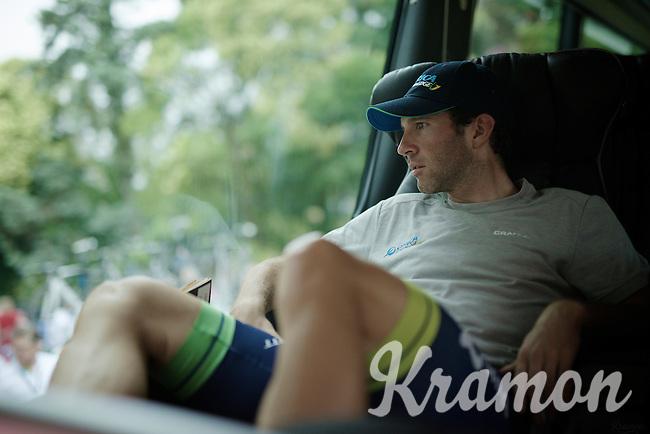 Michael Albasini (SUI/Orica-GreenEDGE) scanning the surroundings around the teambus<br /> <br /> 2014 Tour de France<br /> stage 18: Pau - Hautacam (145km)