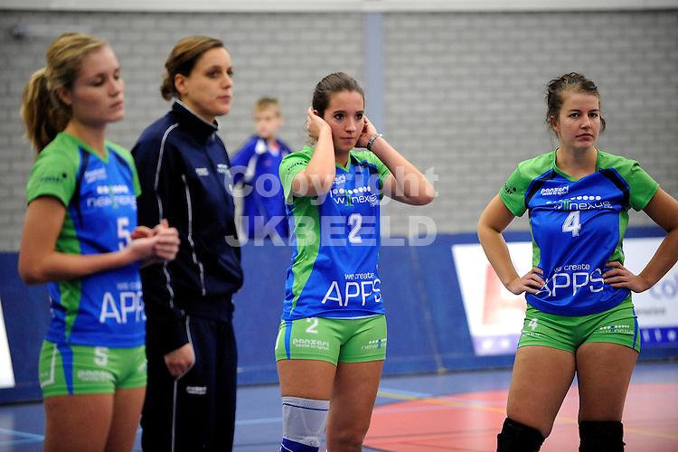 GRONINGEN - Volleybal, Lycurgus - VC Sneek, Eredivisie dames , seizoen 2013-2014, 01-12-2013, teleurstelling bij Lycurgus na verlies met Simone Linstra en Sytske de Boer en Denise Baas