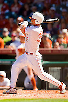 Jonathan Walsh #33 of the Texas Longhorns follows through on his swing against the Arkansas Razorbacks at Minute Maid Park on March 4, 2012 in Houston, Texas.  The Razorbacks defeated the Longhorns 7-3.  Brian Westerholt / Four Seam Images