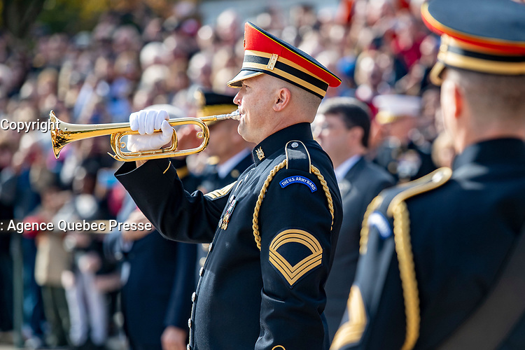 """A bugler from the U.S. Army Band, """"Pershing's Own"""" plays """"Taps"""" during an Armed Forces Full Honors Wreath-Laying at the Tomb of the Unknown Soldier at Arlington National Cemetery, Arlington, Virginia, Nov. 11, 2019. Vice President Mike Pence with Secretary of Veterans Affairs Robert Wilkie participated in the wreath-laying ceremony and later spoke to the crowd in the Memorial Amphitheatre as part of the observance. (U.S. Army photo by Elizabeth Fraser / Arlington National Cemetery / released)"""