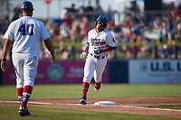 Jose Rodriguez (12) of the Kannapolis Cannon Ballers rounds third base after hitting a home run against the Charleston RiverDogs at Atrium Health Ballpark on July 4, 2021 in Kannapolis, North Carolina. (Brian Westerholt/Four Seam Images)