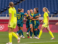 TOKYO, JAPAN - JULY 24: Sam Kerr #2 of Australia celebrates with Caitlin Foord #9 during a game between Australia and Sweden at Saitama Stadium on July 24, 2021 in Tokyo, Japan.