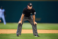 Umpire Jake Wilburn during a game between the Corpus Christi Hooks and Arkansas Travelers on May 29, 2015 at Dickey-Stephens Park in Little Rock, Arkansas.  Corpus Christi defeated Arkansas 4-0 in a rain shortened game.  (Mike Janes/Four Seam Images)