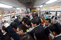 Passengers packed on board a train at Shinjuku station, Tokyo, Japan. With up to 4 million passengers passing through it every day, Shinjuku station, Tokyo, Japan, is the busiest train station in the world. The station was used by an average of 3.64 million people per day.  That's 1.3 billion a year.  Or a fifth of humanity. Shinjuku has 36 platforms, and connects 12 different subway and railway lines.  Morning rush hour is pandemonium with all trains 200% full. <br /> <br /> Photo by Richard jones / sinopix