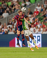 AUSTIN, TX - JUNE 16: Becky Sauerbrunn #4 of the USWNT goes up for a header with Francisca Ordega #17 of Nigeria during a game between Nigeria and USWNT at Q2 Stadium on June 16, 2021 in Austin, Texas.