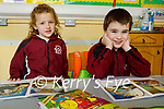 Cammie O'Neil and Killian Birch, enjoying their first day back at school in Muire gan SmálNational School Castleisland on Monday.