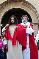 Peter puts a Cloak on Jesus.  Palm Sunday Re-enactment of events in the life of Jesus, by the group called Luna LLena (Full Moon), a group of volunteers in Antigua, Guatemala.