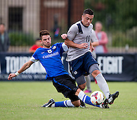 Brandon Allen (10) of Georgetown is tackled by Brendan Hines-Ike (6) of Creighton during the game at Shaw Field on the campus of the Georgetown University in Washington, DC.  Georgetown tied Creighton, 0-0, in double overtime.