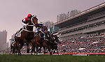 HONG KONG - DECEMBER 12:  Riders compete at the Dublin Handicap race during the Cathay Pacific International Races at the Sha Tin Racecourse on December 12, 2010 in Hong Kong, Hong Kong. Photo by Victor Fraile / The Power of Sport Images