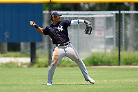 FCL Yankees outfielder Jasson Dominguez (25) warms up during a game against the FCL Tigers on June 28, 2021 at Tigertown in Lakeland, Florida.  (Mike Janes/Four Seam Images)