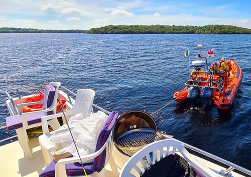 A busy Lough Ree RNLI volunteer lifeboat crew tow a cruiser that had gone aground