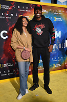 """LOS ANGELES - FEBRUARY 26: John Salley (R) and Taya Salley attend National Geographic's 2020 Los Angeles premiere of """"Cosmos: Possible Worlds"""" at Royce Hall on February 26, 2020 in Los Angeles, California. Cosmos: Possible Worlds premieres Monday, March 9 at 8/7c on National Geographic. (Photo by Frank Micelotta/National Geographic/PictureGroup)"""