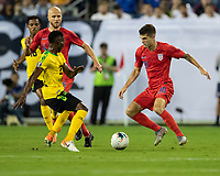NASHVILLE, TN - JULY 3: Devon Williams #22 defends against Christian Pulisic #10 during a game between Jamaica and USMNT at Nissan Stadium on July 3, 2019 in Nashville, Tennessee.