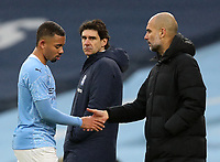 10th January 2021; Etihad Stadium, Manchester, Lancashire, England; English FA Cup Football, Manchester City versus Birmingham City; Manchester City manager Pep Guardiola shakes hands with  Gabriel Jesus of Manchester City as he is subsituted