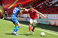 Jason Pearce of Charlton tries to shake off a challenge from Wigan's Joe Williams during Charlton Athletic vs Wigan Athletic, Sky Bet EFL Championship Football at The Valley on 18th July 2020