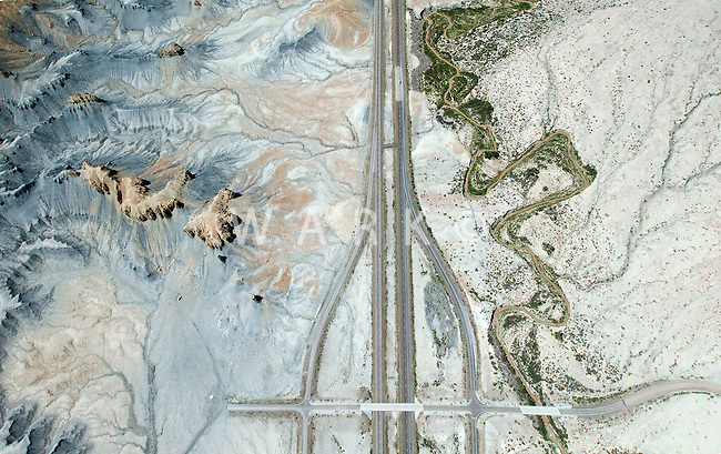 I-70 interstate highway with exit ramps into the desert