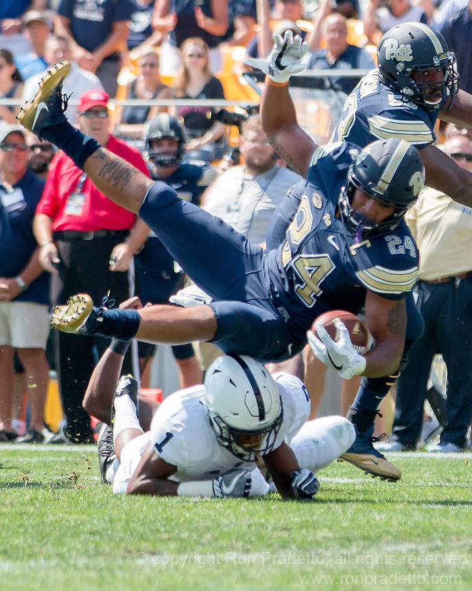 Pitt running back James Conner lands on Penn State cornerback Christian Campbell. The Pitt Panthers defeated the Penn State Nittany Lions 42-39 at Heinz Field, Pittsburgh, Pennsylvania on September 10, 2016.