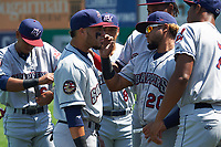 Mahoning Valley Scrappers Jason Rodriguez (20) helps Jonathan Laureano (25) with eye black during warmups before the first game of a doubleheader against the Auburn Doubledays on July 2, 2017 at Falcon Park in Auburn, New York.  Mahoning Valley defeated Auburn 3-0.  (Mike Janes/Four Seam Images)