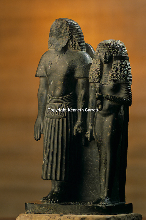 Statue of  Khaemwaset and wife; reign of Amenhotep III,Tutankhamun and the Golden Age of the Pharaohs, Page 63