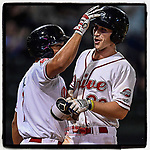 Right fielder Ryan Scott (30) of the Greenville Drive, right, is congratulated by Tyler Hill (7) after hitting a home run in Game 3 of the South Atlantic League Championship series against the Kannapolis Intimidators on Thursday, September 14, 2017, at Fluor Field at the West End in Greenville, South Carolina. Kannapolis won, 5-4. Greenville leads the series 2-1. (Tom Priddy/Four Seam Images)