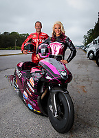 May 3, 2019; Commerce, GA, USA; NHRA pro stock motorcycle rider Angie Smith (right) and husband Matt Smith pose for a portrait prior to qualifying for the Southern Nationals at Atlanta Dragway. Mandatory Credit: Mark J. Rebilas-USA TODAY Sports