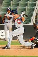 Rick Hague #18 of the Hagerstown Suns follows through on his swing against the Kannapolis Intimidators at Fieldcrest Cannon Stadium August 8, 2010, in Kannapolis, North Carolina.  Photo by Brian Westerholt / Four Seam Images