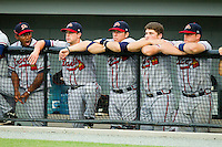 Members of the Danville Braves watch the action from the dugout during the Appalachian League game against the Burlington Royals at Burlington Athletic Park on July 18, 2012 in Burlington, North Carolina.  The Royals defeated the Braves 4-3 in 11 innings.  (Brian Westerholt/Four Seam Images)