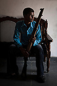 Santham Ram Hapka, a former naxal member who surrendered and joined the Special Police Force poses for a portrait in Bhairamgarh, Chhattisgarh, India. Photo: Sanjit Das/Panos for The Times