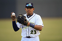 Right fielder Guillermo Granadillo (23) of the Columbia Fireflies warms up before a game against the Rome Braves on Saturday, August 17, 2019, at Segra Park in Columbia, South Carolina. Rome won, 4-0. (Tom Priddy/Four Seam Images)