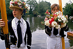 Eton schoolboy in floral hat Founders Day Parents day June 4th celebrations. These boys will take part in the Procession of Boats.  <br /> Wearing traditional floral hats. .