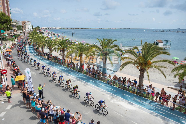 The peloton pass Playa de Villananitos during Stage 8 of La Vuelta d'Espana 2021, running 173.7km from Santa Pola to La Manga del Mar Menor, Spain. 21st August 2021.     <br /> Picture: Cxcling | Cyclefile<br /> <br /> All photos usage must carry mandatory copyright credit (© Cyclefile | Cxcling)