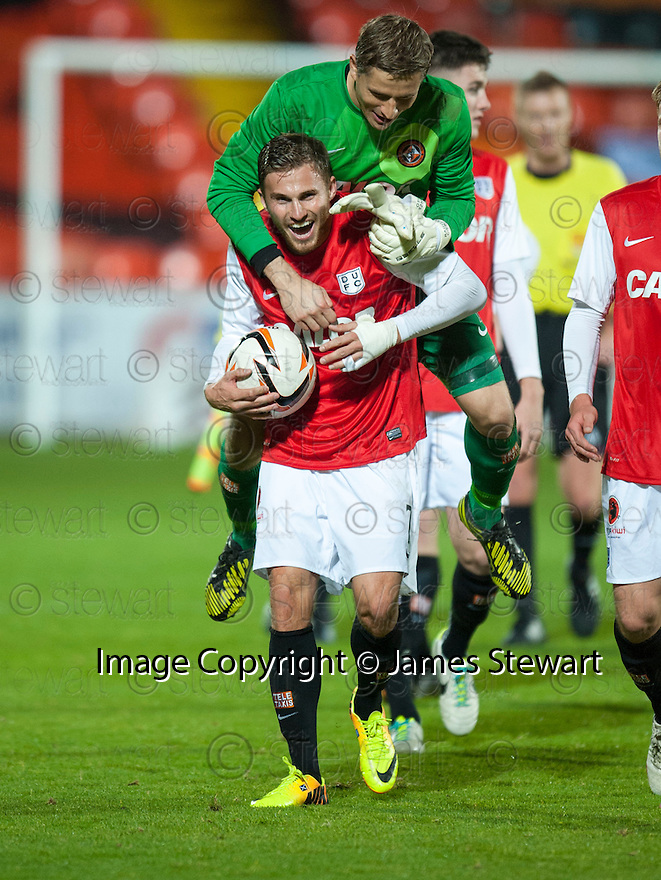 Dundee Utd's David Goodwillie is congratulated by keeper Radoslaw Cierzniak at the end of the game.