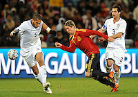 Fernando Torres (9) of Spain runs at Oguchi Onyewu (5)  and Carlos Bocanegra (3) of USA. USA defeated Spain 2-0 during the semi-finals of the FIFA Confederations Cup at Free State Stadium in Manguang/Bloemfontein, South Africa on June 24, 2009..