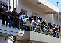 Pictured: Locals gather on balconies to watch Prince Charles and wife the Duchess of Cornwall visit the village of Arhanes on the island of Crete, Greece. Friday 11 May 2018 <br /> Re: HRH Prnce Charles and his wife the Duchess of Cornwall visit thevillage of Arhanes near Heraklion, Greece.