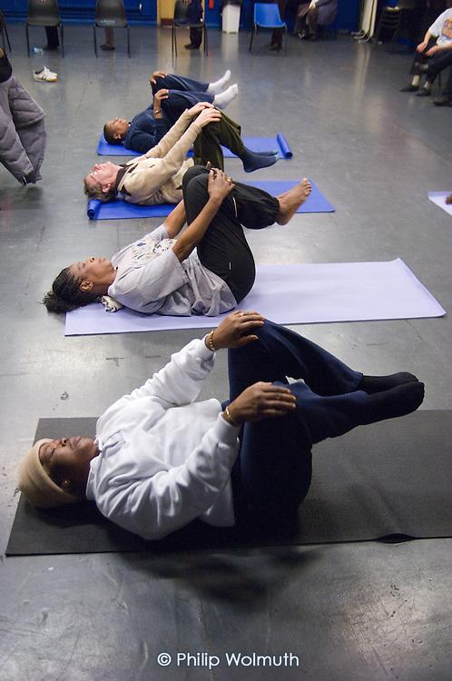 Yoga session at Open Age open day at Paddington Arts