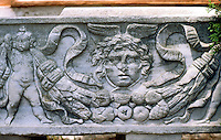 Greek Art:  Sarcophagus--Ostia.  Putto, winged head, fruits. Photo '83.